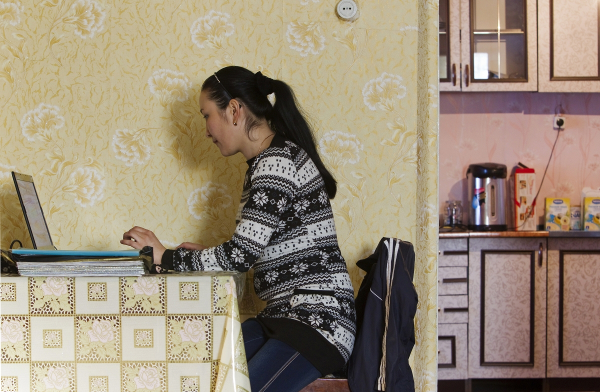 Woman uses the internet in Kazakhstan
