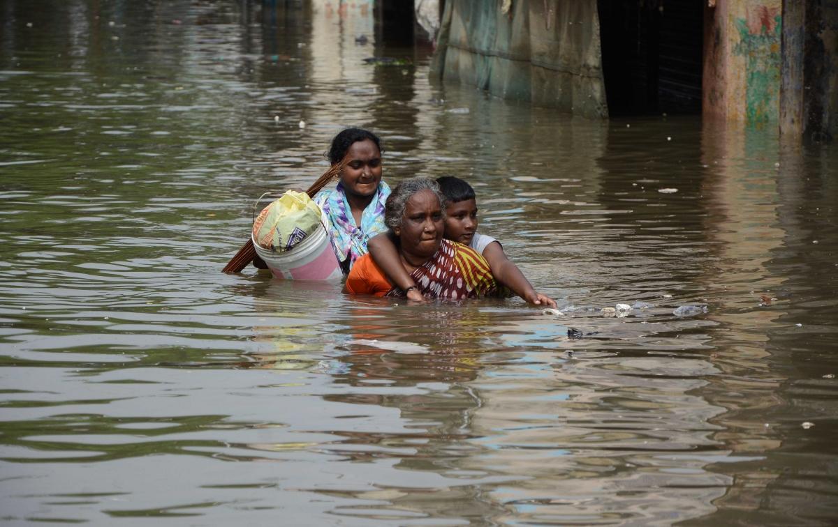 Women walk in Chennai floods