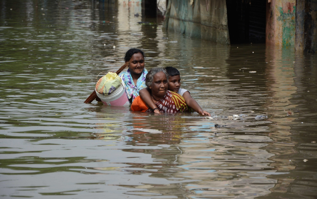 Women walk in Chennai floods