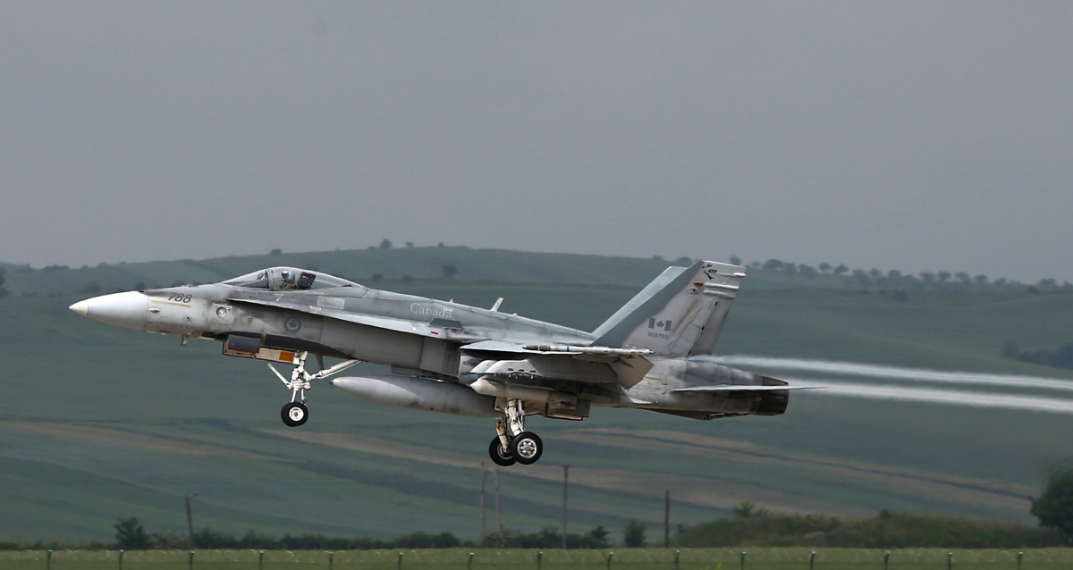 Canadian F-18 Hornet takes off from an