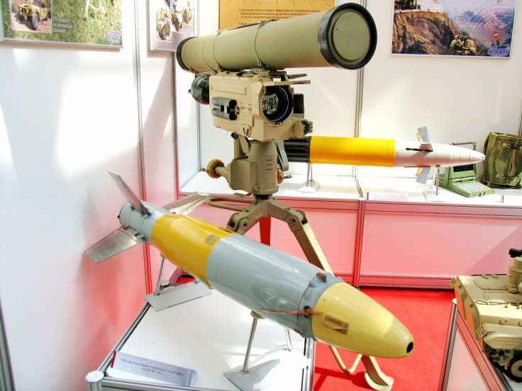9M133 missile with launcher