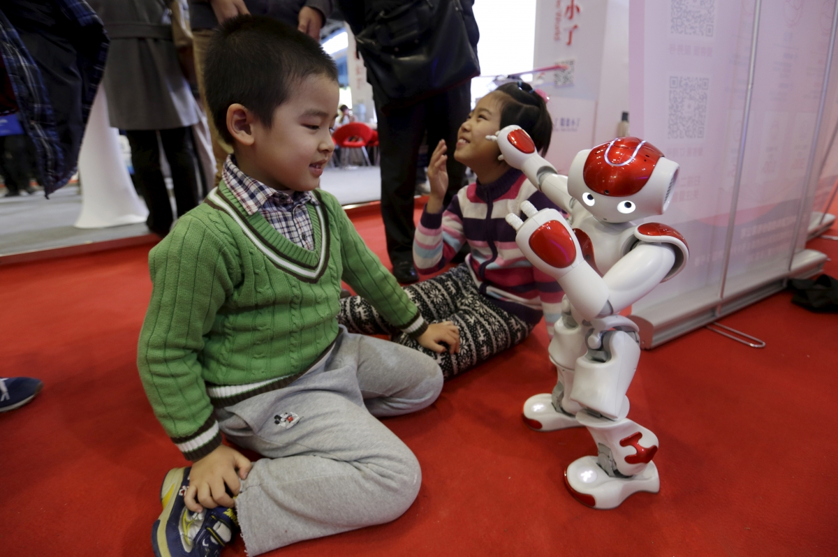Nao humanoid robot plays with children