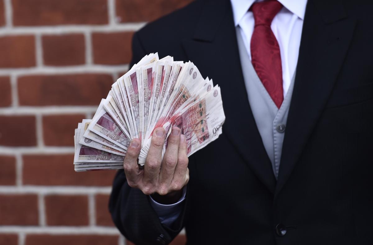 File image of man holding cash