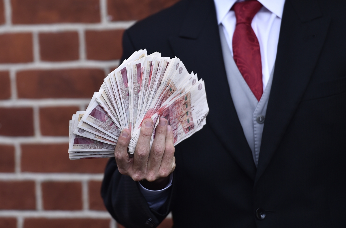 File image of man holding cash