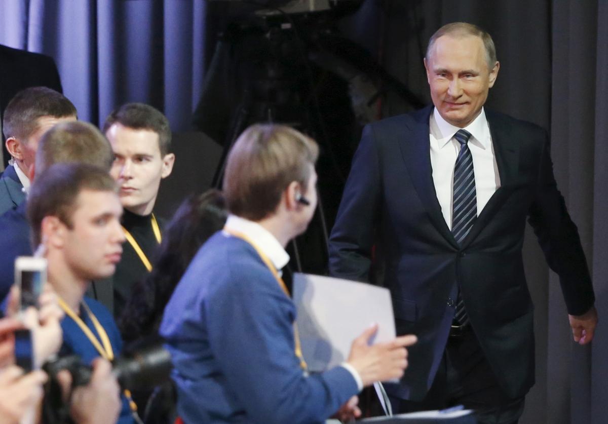 Putin enters room