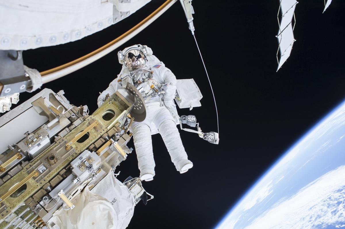 Astronauts go on spacewalk to fix ISS's rail car