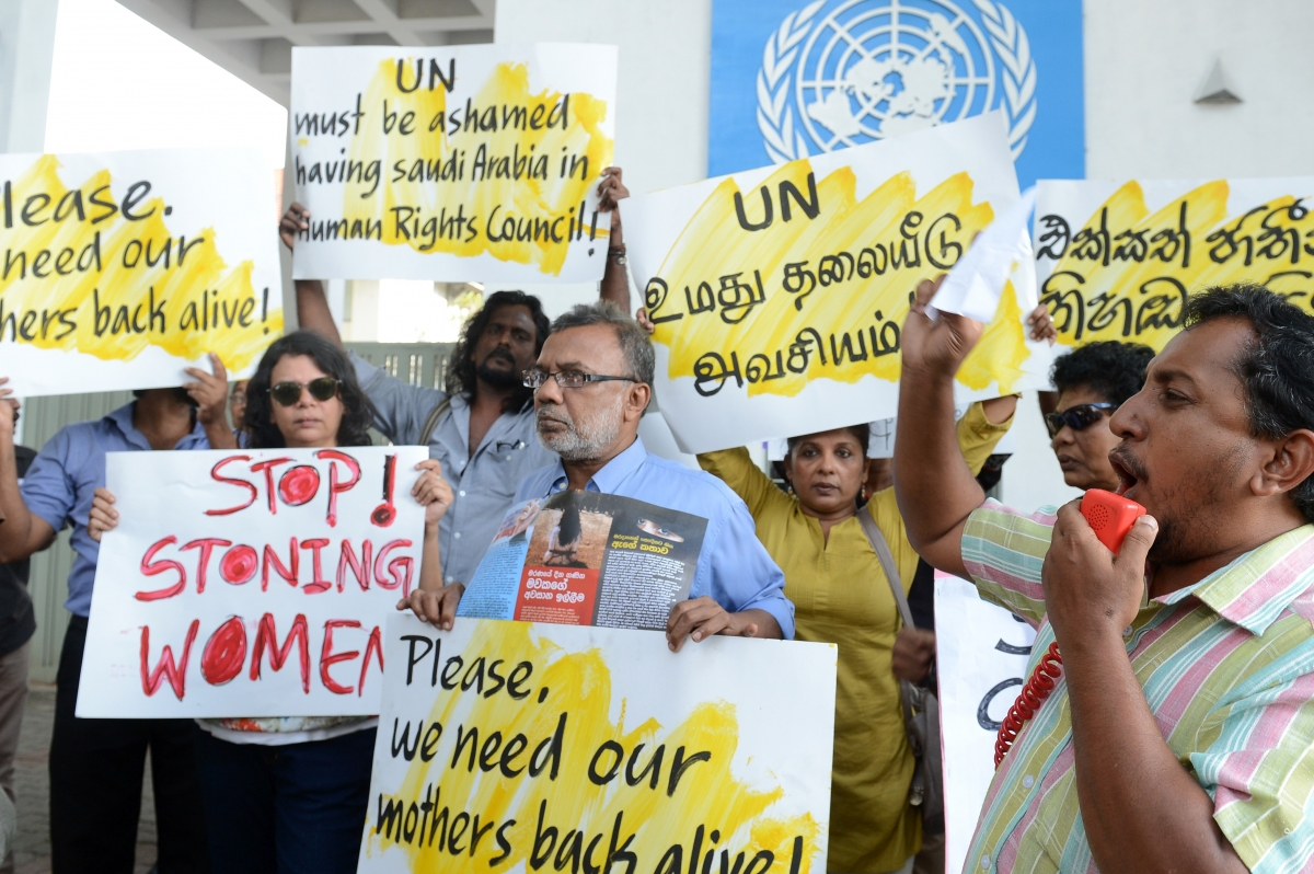 Protesters stage a demonstration outside the UN