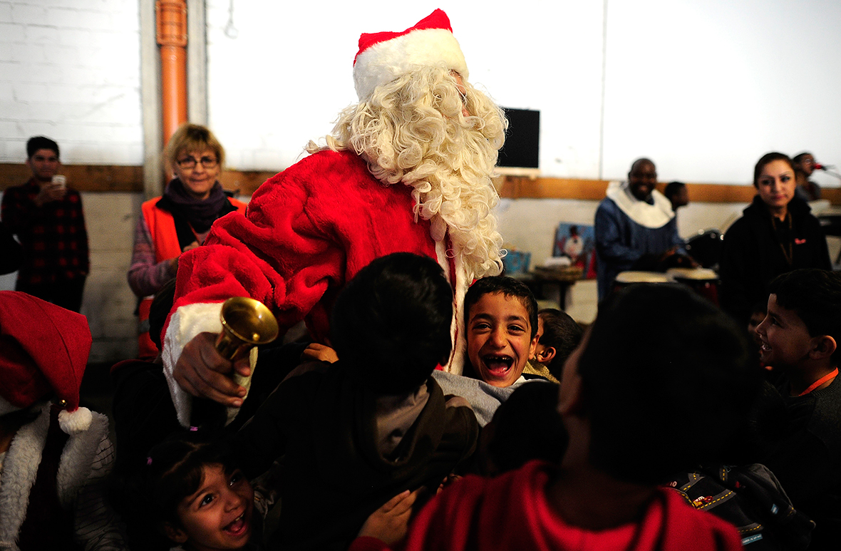 Migrants In Germany Refugee Children Sing Christmas Carols And Get Gifts From Santa Claus