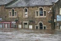 Flood waters in Mytholmroyd in West Yorkshire