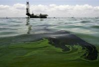 Oil spill on water is seen near an oil production facility at Maracaibo lake near the coastal town of Barranquitas