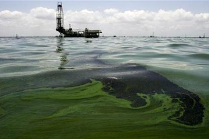 Oil spill on water is seen near an oil production facility at Maracaibo lake near the coastal town of Barranquitas