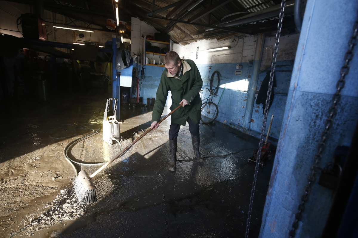man cleans after york floods