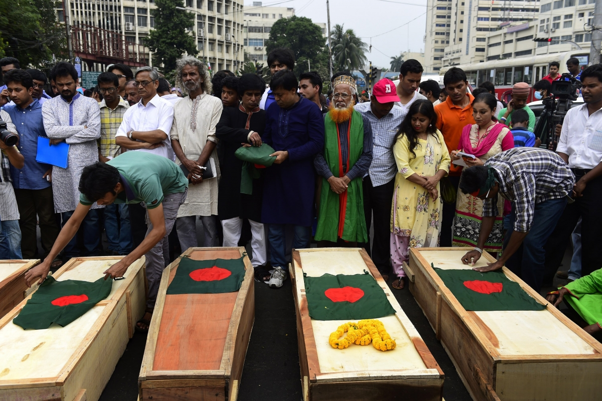 Protesters with coffins symbolising