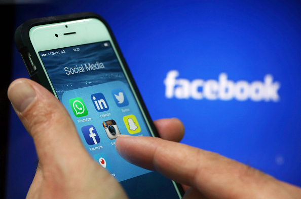 Facebook and Twitter staff could face prison term in the UK if users are warned about surveillance