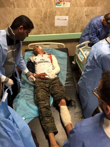 An injured man receives treatment