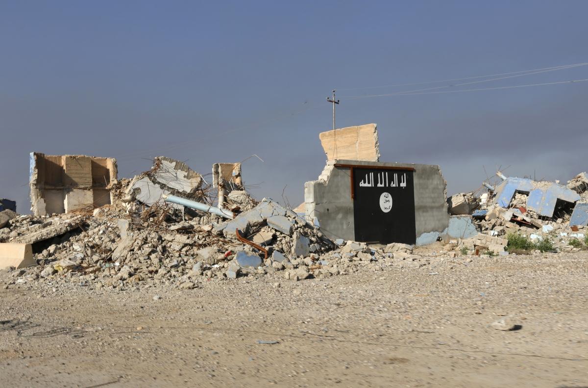 isis symbol bombed wall
