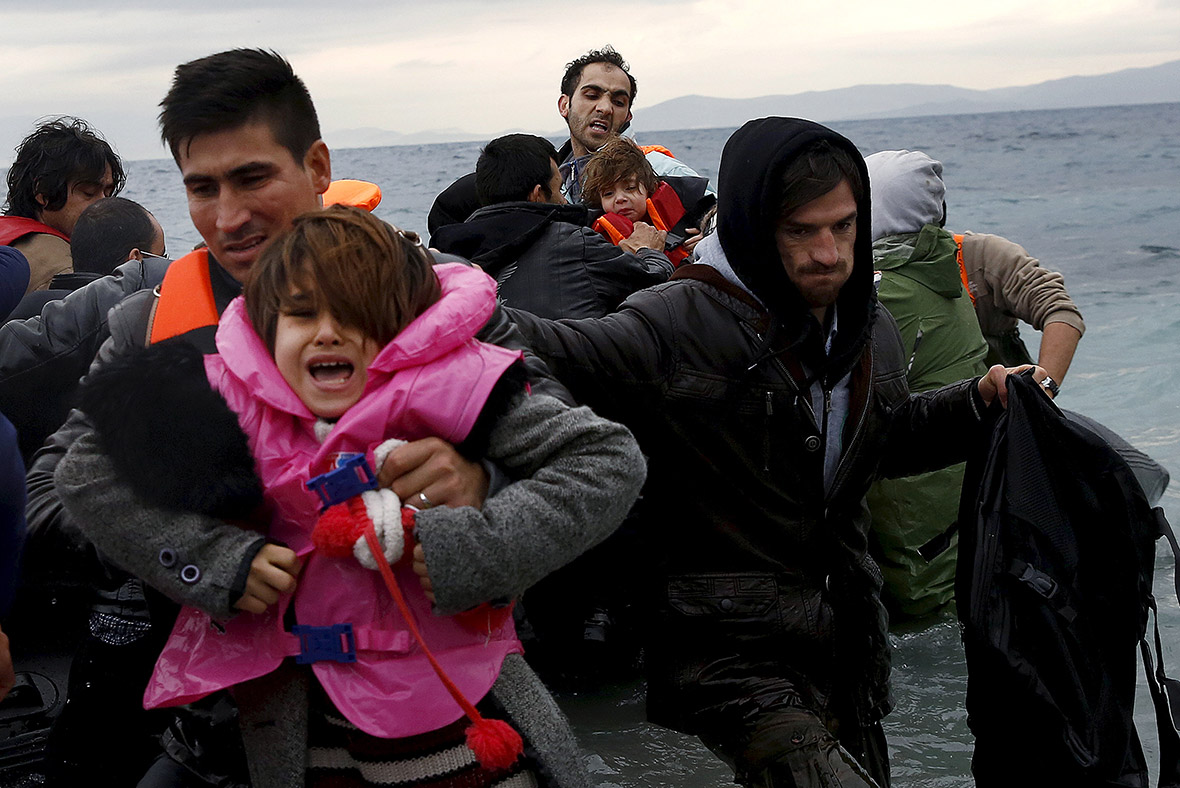 Refugees arrive on an inflattable raft on the Greek island of Lesbos