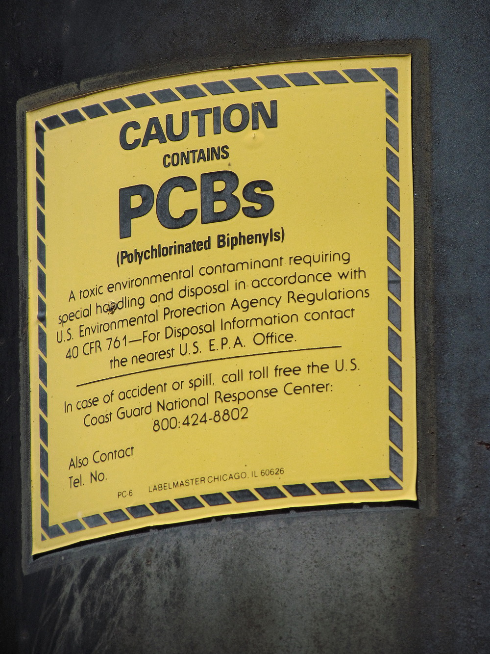 caution contains pcbs