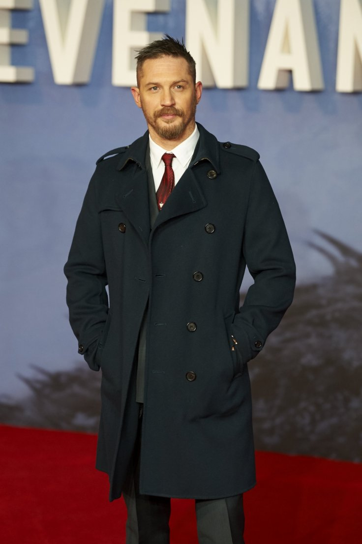 dbfcdd9b7 The Burberry wool trench was a perfect addition to Tom Hardy's look and a  nice contrast against the grey hue of his crisp suit Getty