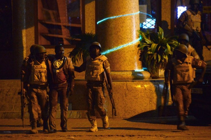 Burkina Faso Splendid Hotel soldiers and man