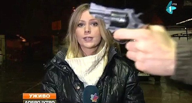 Man waves gun at reporter on liveTV