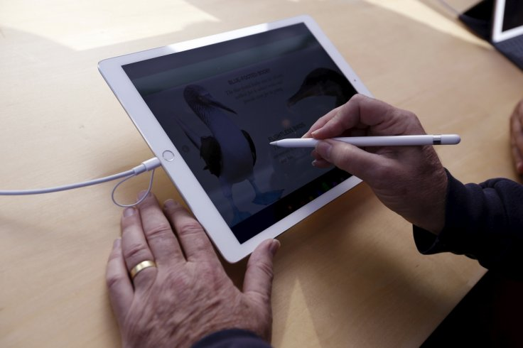 Someone using an Apple iPad Pro