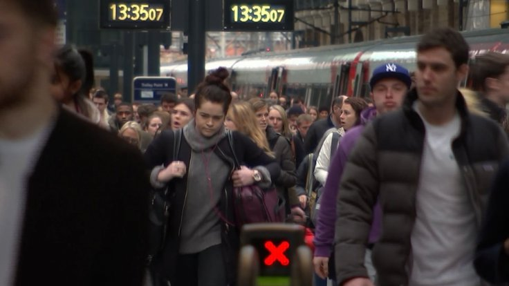 Commuters using trains in London