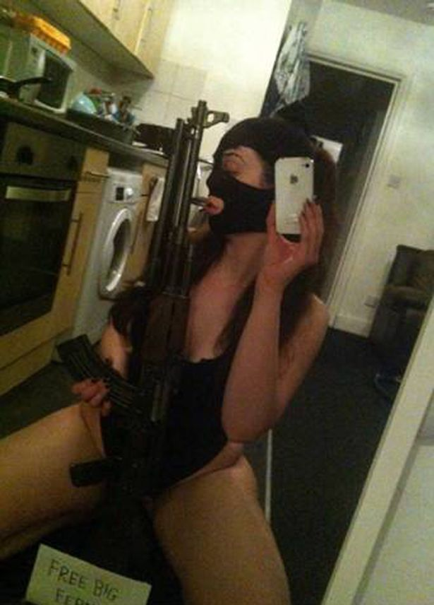 Cailtin Adams posing with an AK-47