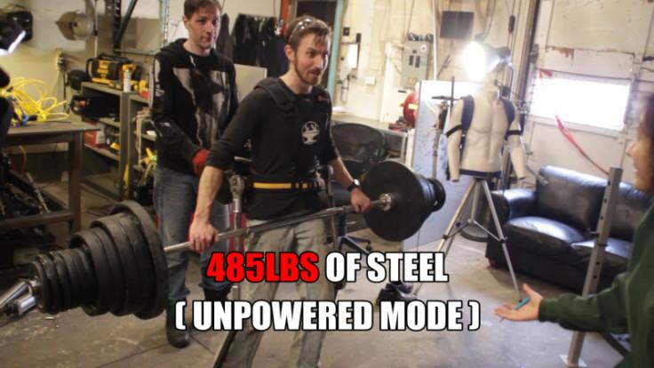 Iron Man exoskeleton lifts car