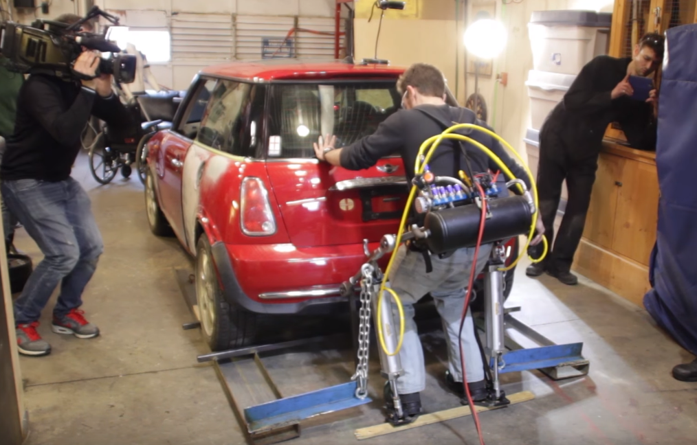 Watch This Real Life Iron Man Lift Up A Car Using His Home