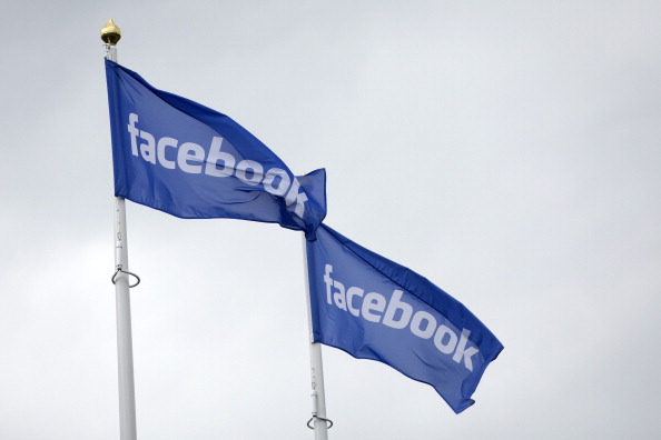 Facebook shares soar as mobile drive and add sales surpass expectations