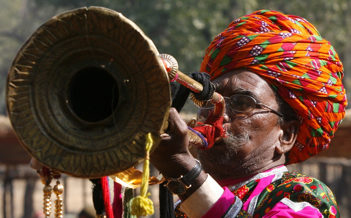 Man blowing horn