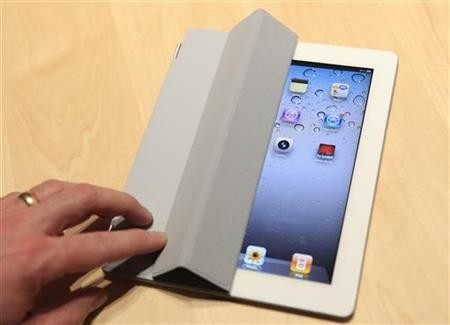 The iPad 2 with a Smart Cover is shown in use in the demonstration area after the iPad 2 launch during an Apple event in San Francisco,