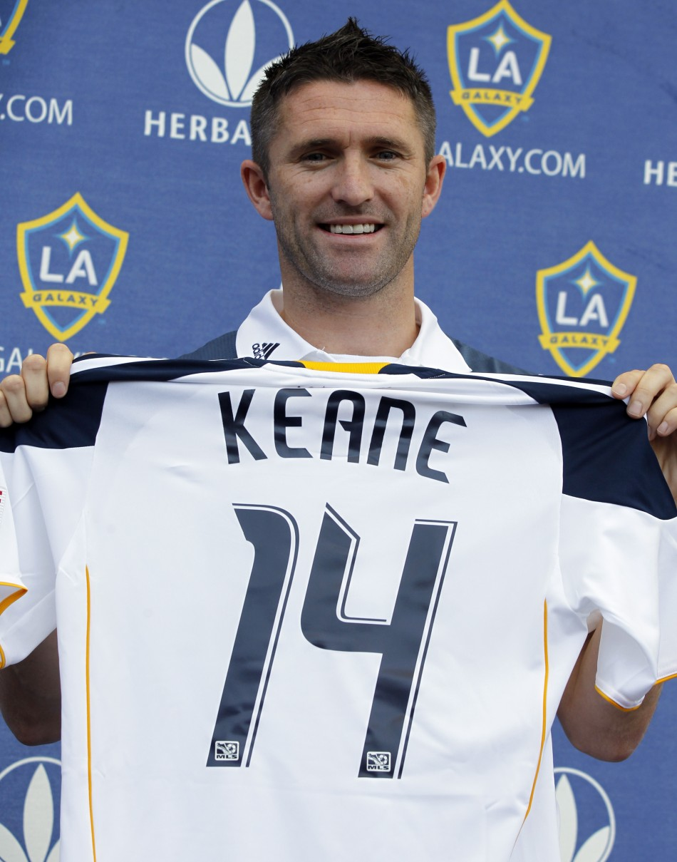 Ireland's Robbie Keane holds up a jersey after signing with MLS soccer team Los Angeles Galaxy in Carson, California