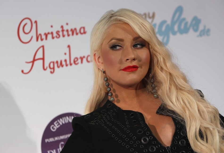 US singer Aguilera poses during a photocall to promote her new perfume collection in Munich