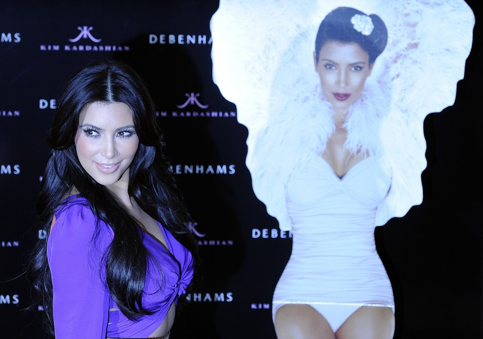 U.S. television celebrity Kim Kardashian poses for photographers as she launches her perfume at a store in central London