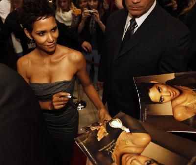 Halle Berry signs autographs following her arrival in Warsaw to promote her new perfume, Reveal