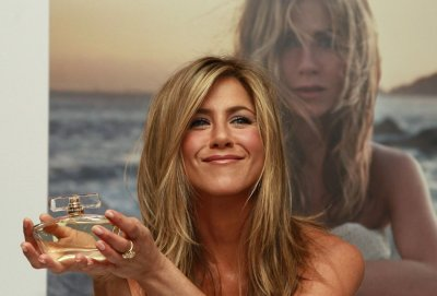U.S. actress Jennifer Aniston poses with her fragrance 039Jennifer Aniston039 during its launch at Harrods in London