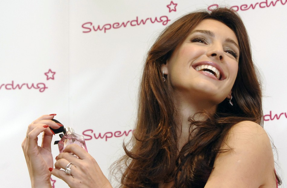 British Model Kelly Brook poses at the launch of her new perfume named Kelly Brook in London