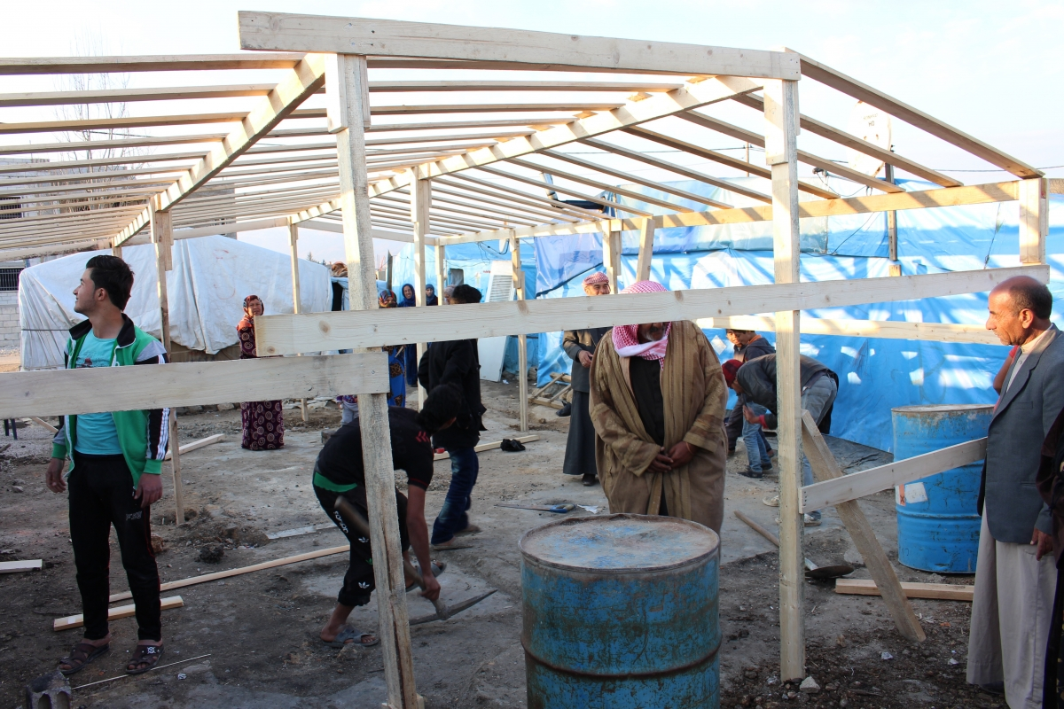 Syrian refugees raise the house in Lebanon