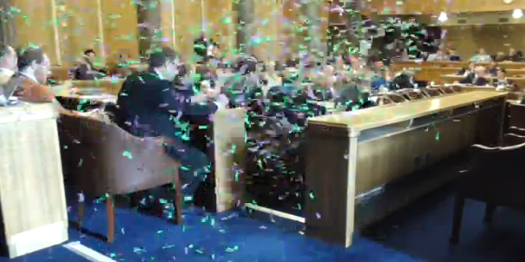 Protesters released confetti at the council meeting