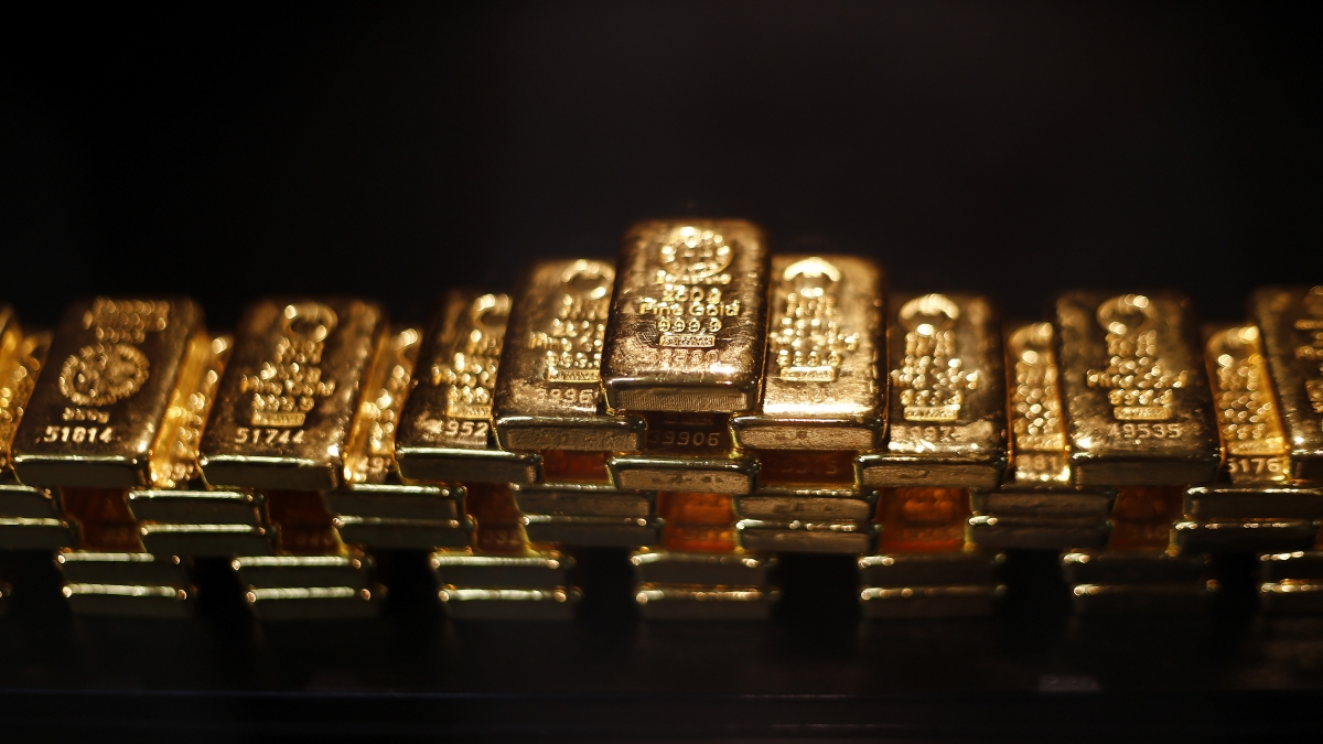 Gold touches new high amid financial uncertainty, a lower dollar and tumbling stock prices