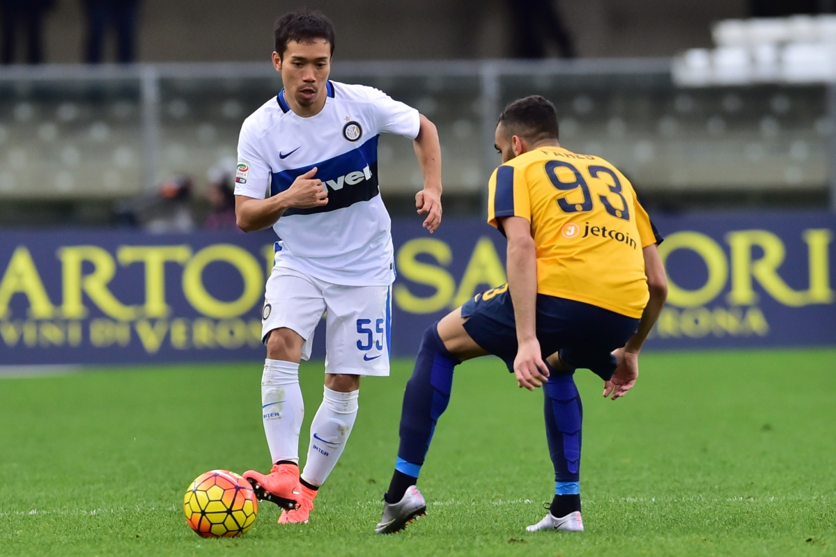 Inter Milan's defender from Japan Yuto Nagatomo (L) fights for the ball with Hellas Verona's midfielder from France Mohamed Fares during the Italian Serie A football match Verona vs Inter Milan at the Bentegodi Stadium in Verona on Febrauary 7, 2016