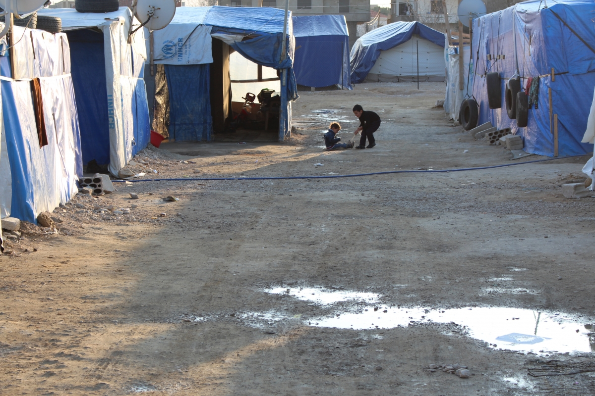 Two children play in the street