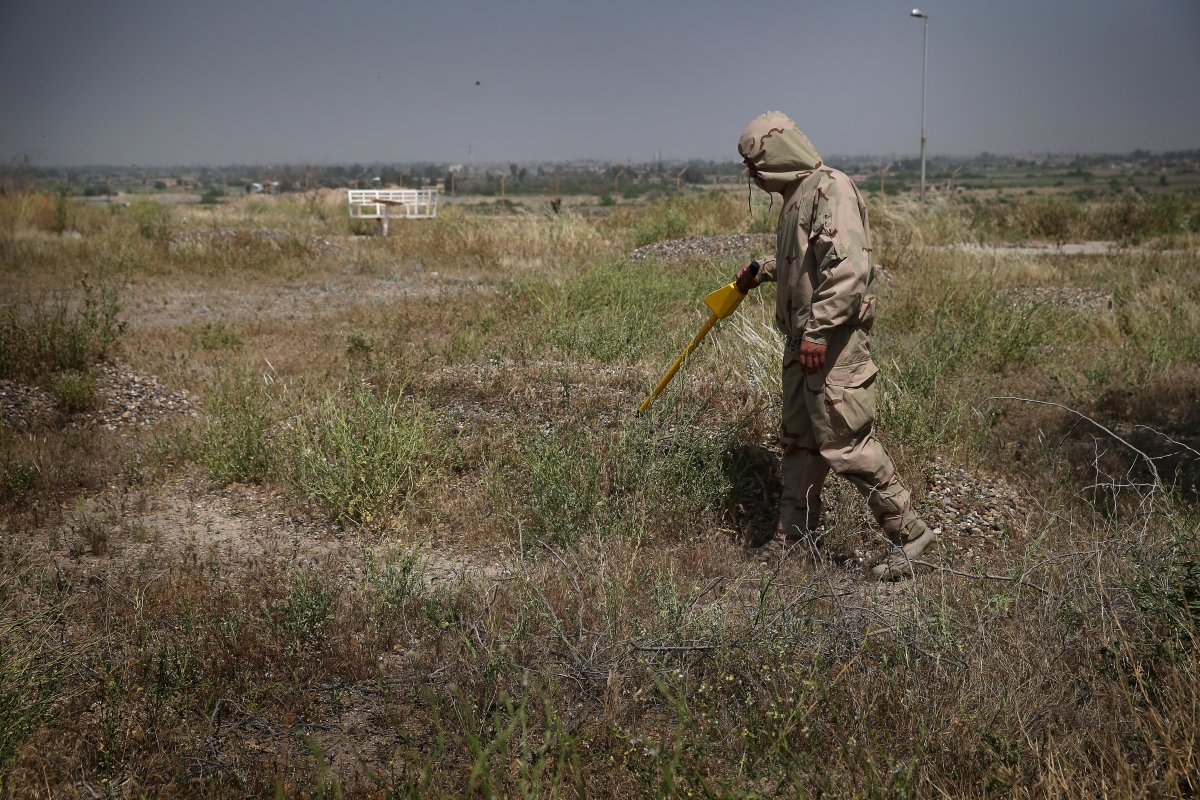 An Iraqi soldier tests for chemical weaponS