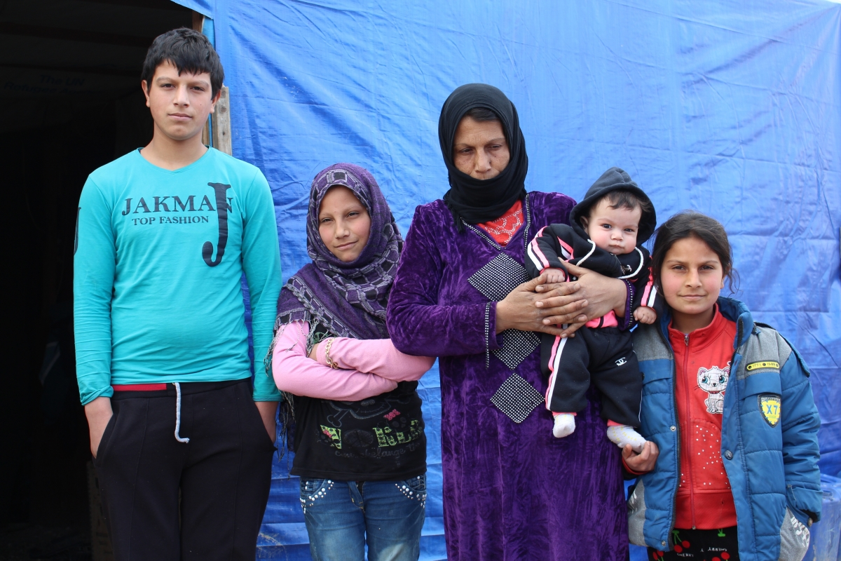 Mouamar and her family in the Bekaa