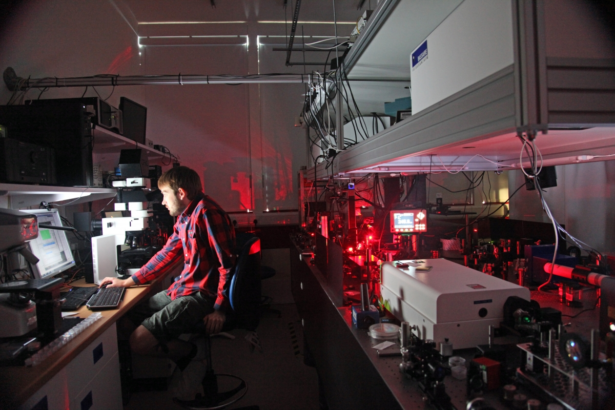 Femtosecond lasers writing data to glass