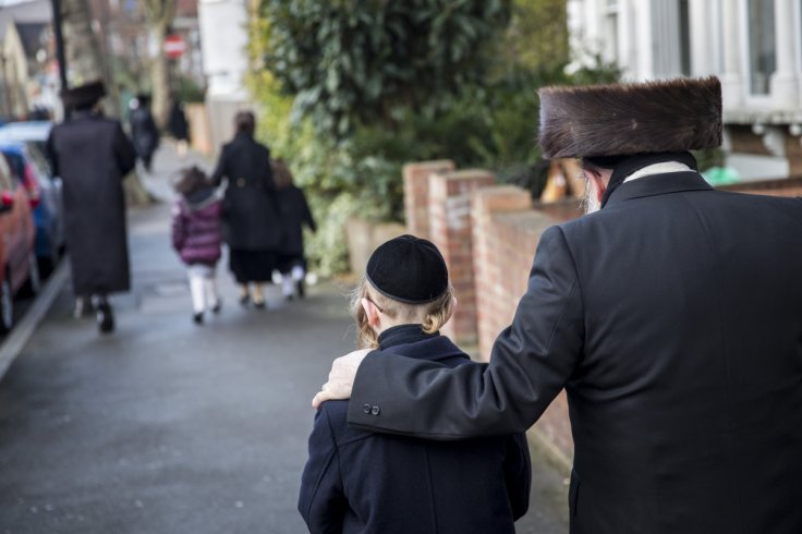 Members of the Jewish community in Stamford Hill