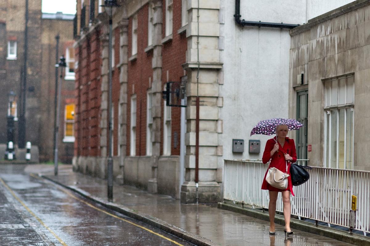 Woman walking in the rain
