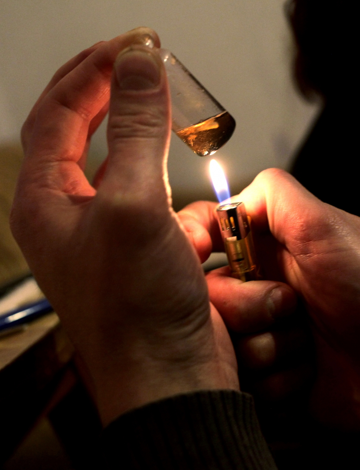 A man prepares heroin for in injection